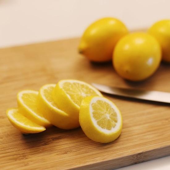 lemons sliced on a cutting board