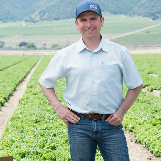 worker standing in a field