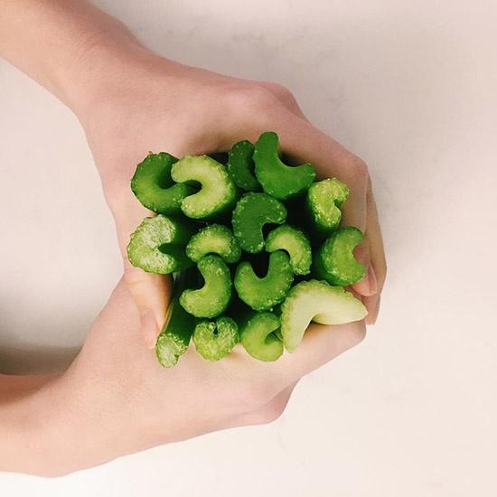 hands holding a bunch of Dandy celery sticks