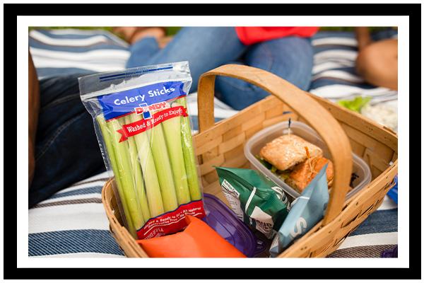 package of Dandy celery sticks in picnic basket